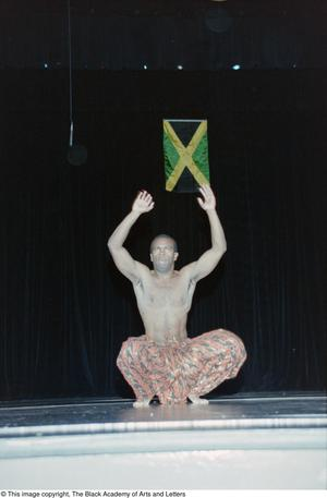 Primary view of object titled '[Male performer dancing at Ashe Caribbean event]'.