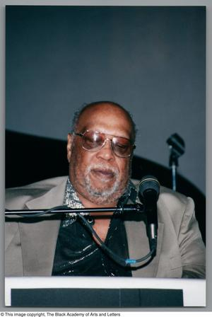 Primary view of object titled '[Close-up of Les McCann looking downward while playing piano]'.