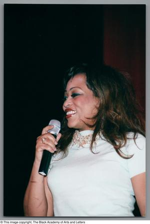 Primary view of [Miki Howard smiling while gazing out into audience]