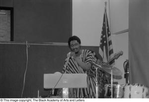Primary view of [Photograph of the drummer speaking into the microphone]
