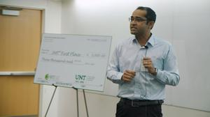 Primary view of object titled '[Photograph of ABM Rezbaul Islam at the Fall 2018 Three Minute Thesis (3MT®) Final Competition]'.