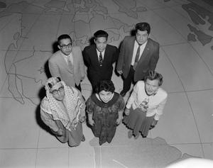 Primary view of [Students posing on a floor map]