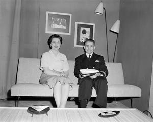 Primary view of [Margaret McDonald and a guest in his Marine uniform]