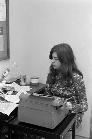 Primary view of [Female employee using a typewriter, 2]