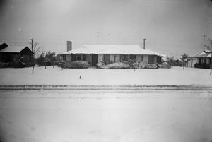 Primary view of [Photograph of a stone house covered in snow, 3]