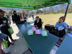 Primary view of [Baseball cap decorating table outside the UNT Union during UnionFest]