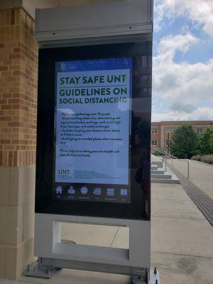 [COVID-19 digital signage outside the University Union]
