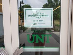 [COVID-19 signage in University Union]