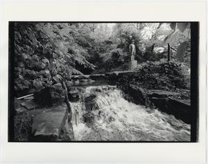 Primary view of object titled '[Jack Daniel's Distillery Cave Spring with Statue]'.