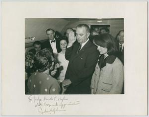 Primary view of object titled '[Lyndon B. Johnson taking oath of office from Sarah T. Hughes]'.