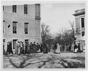 Primary view of object titled '[Students passing between classes at North Texas State Normal College]'.