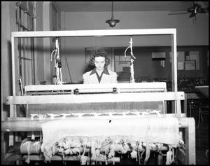 Primary view of object titled '[Dora Katherine Adams working at loom at North Texas State Teachers College]'.