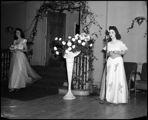 Primary view of object titled '[Edie Adams entering room at social event at North Texas State Teachers College]'.