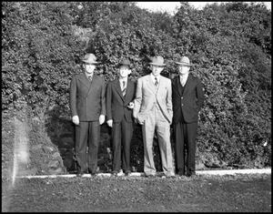 Primary view of object titled '[College administrative staff on grounds at North Texas State Teachers College]'.