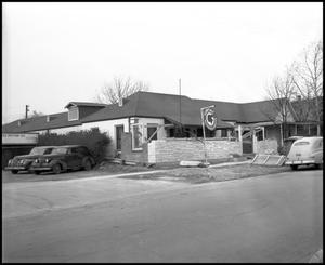 Primary view of object titled '[Pontiac Authorized Service Business in Denton Area, 1942]'.