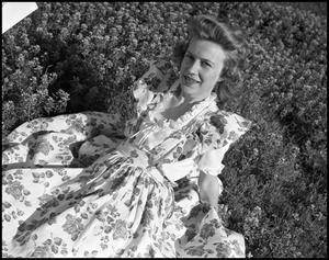 Primary view of object titled '[Avesta Favorite Edna Jo Allen Posing in a Field #1, 1944]'.