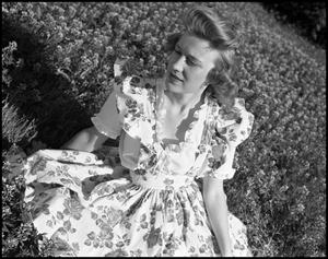 Primary view of object titled '[Avesta Favorite Edna Jo Allen Posing in a Field #2, 1944]'.