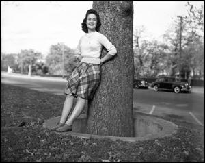 Primary view of object titled '[Marie Austin Posing on a Tree]'.