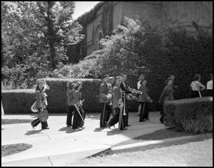 Primary view of object titled '[Marching Band Visiting a High School, 1942]'.