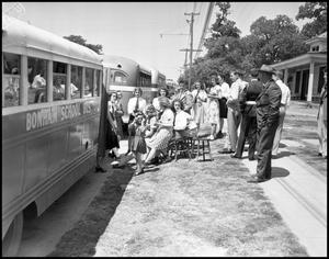 Primary view of object titled '[Marching Band Boarding Bonham School Bus, 1942]'.