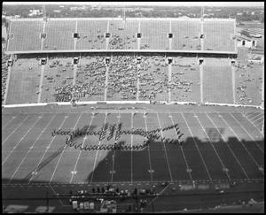 Primary view of object titled '[Marching Band at Cotton Bowl, 1960]'.