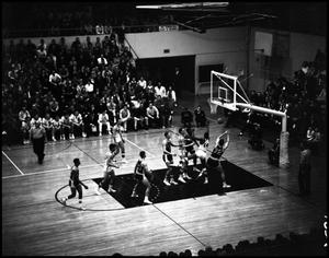 Primary view of object titled '[Basektball - Men - Game - NT vs St. Louis U. - 1963 - Spectator view point]'.
