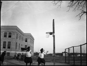 Primary view of object titled '[Basketball #4 - Women - Game - Outdoors - 1900s]'.