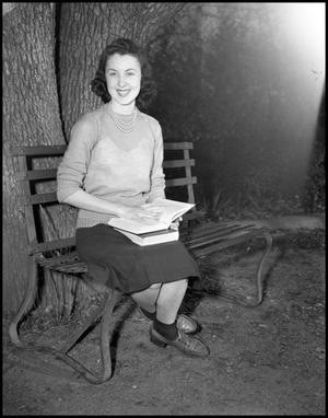 Primary view of object titled '[Velma Rae Bateman Sitting on a Park Bench]'.
