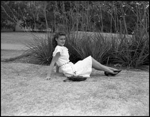 Primary view of object titled '[Frances Bazoori on Campus Grounds in White Dress]'.