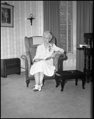 Primary view of object titled '[Elder woman in chair]'.