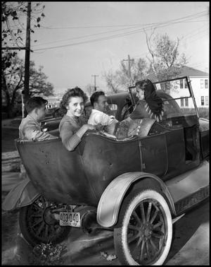 Primary view of object titled '[Betty Berry in a Car with other Students]'.