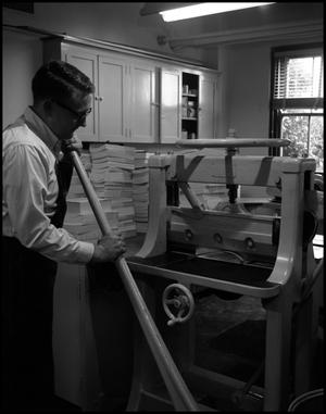 Primary view of object titled '[Book Bindery - Process - Male Individual with Machine - 1963]'.