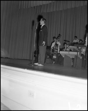 Primary view of object titled '[Boone, Pat - Performing on Stage Show with Band]'.