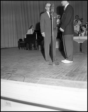 Primary view of object titled '[Boone, Pat - Receiving Award at Stage Show]'.