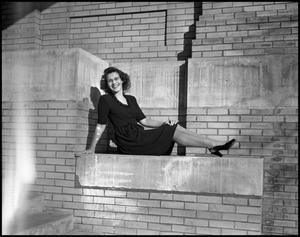 Primary view of object titled '[Arlitta Bowles Posing on Brick Building]'.