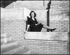 Primary view of object titled '[Arlitta Bowles Posing on Brick Building #2]'.