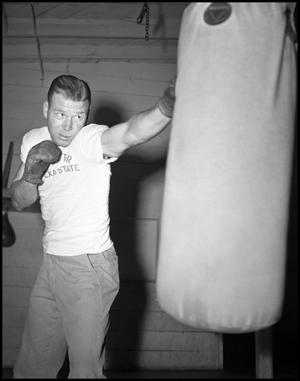 Primary view of object titled '[Bob Brady with Punching Bag]'.