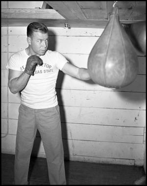 Primary view of object titled '[Bob Brady Boxing with Punching Bag]'.