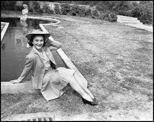 Primary view of object titled '[Lila Bratcher Posing Near Fountain]'.