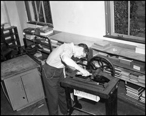 Primary view of object titled '[Ben Brooks Working with a Mechanism]'.