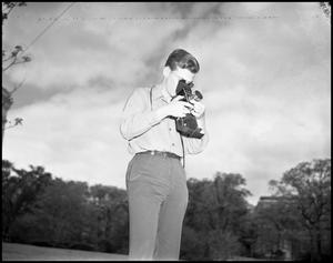 Primary view of object titled '[Dale Bryant Taking A Photograph]'.