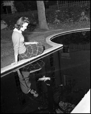 Primary view of object titled '[Edith Butler next to Fountain]'.