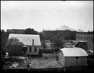 Primary view of object titled '[Campus - Aerial - Old Main view from behind houses]'.