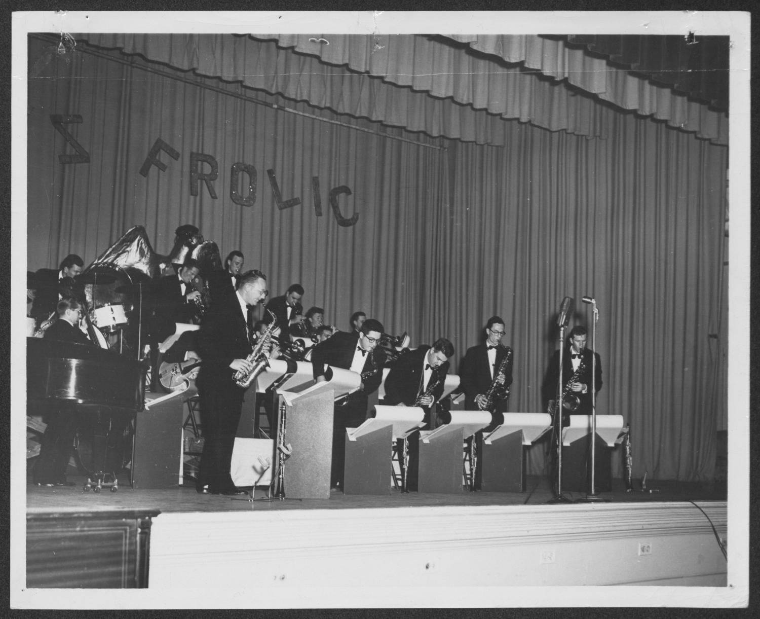 [Photograph of Gene Hall and the Laboratory Dance Band Performing on Stage]                                                                                                      [Sequence #]: 1 of 2