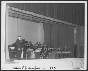 Primary view of object titled '[Photograph of Dan Alexander Singing Alongside the Laboratory Dance Band]'.