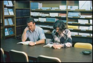 Primary view of object titled '[Two Students in the Career and Placement Library]'.