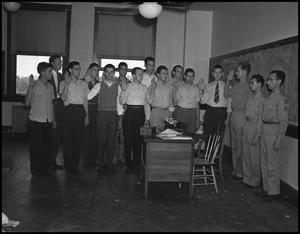 Primary view of object titled '[Campus Men Pledging, 1942]'.