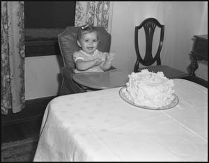 Primary view of object titled '[A Little Girl and her Birthday Cake, 1942]'.