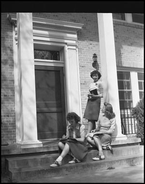 Primary view of object titled '[Campus Students Studying Outside, 1942]'.