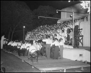Primary view of object titled '[Campus Choir Performing Outside at Night]'.